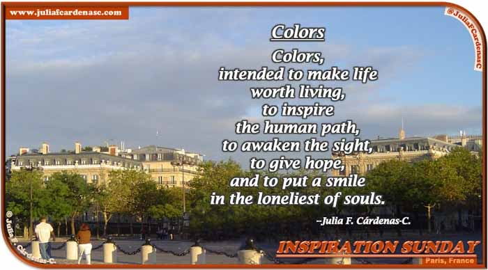 Poem-In-A-Photo. Poem about the effect of color on the human mind. Photo of a non-busy street in Paris, France. There are green, tall trees almost covering the buildings behind them. The blue sky is a is almost covered by gray clouds. @JuliaFCardenasC