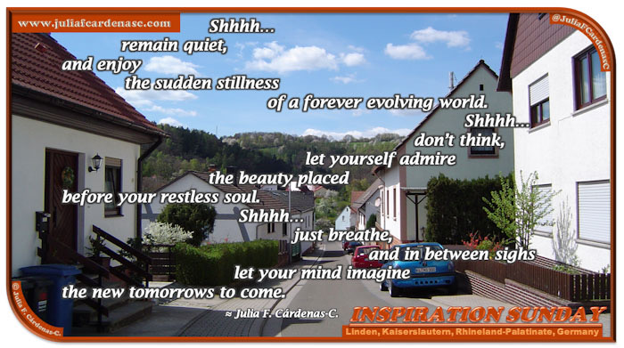 Poem-In-A-Photo. Poem about the human spirit always moving, always curious, always wondering about tomorrow. Poem over a landscape inspirational photo of Linden, Germany. A contrast of the blue sky, nature's green and the houses. @JuliaFCardenasC